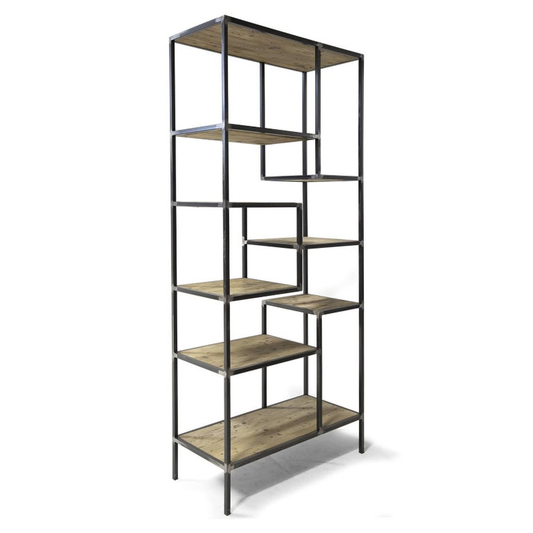 This Minimalist and elegant bookcase will be an eye-catching addition to a rustic or industrial setting, providing a striking decorative element for a wall and at the same a versatile display space for books and collectibles. Its structure was