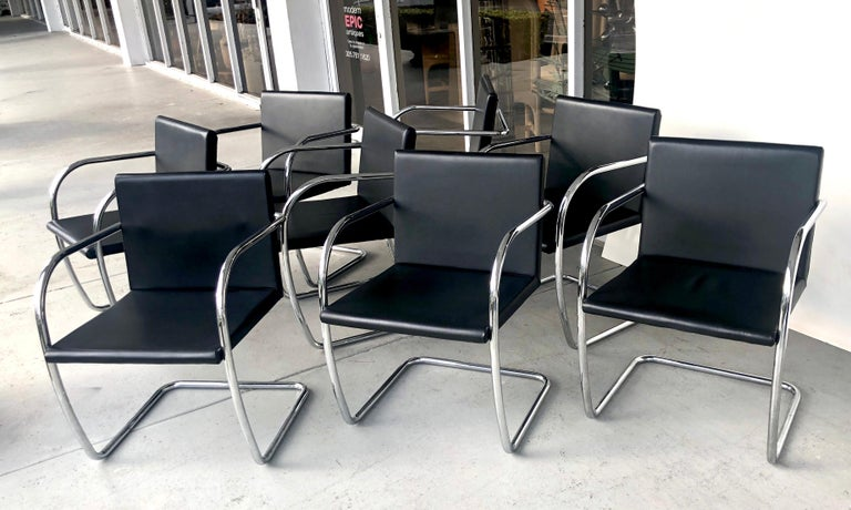 A set of 8 thin pad Brno chairs. Original black leather upholstery with chrome frames.