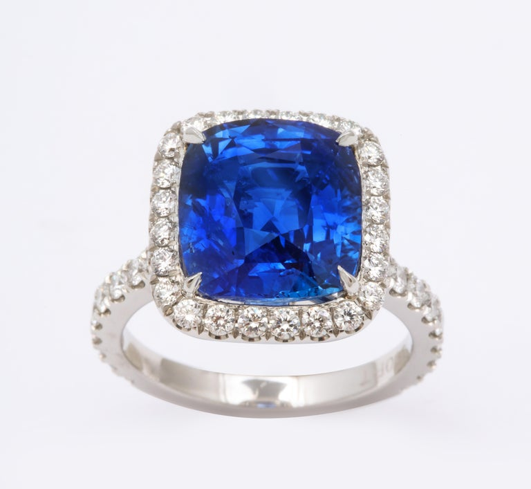 A beautiful Certified Ceylon Blue Sapphire set in a custom diamond halo mounting.   8.06 carat cushion cut blue sapphire   1.02 carats of white round brilliant cut diamonds, set in platinum.   This ring was designed to showcase the sapphire but