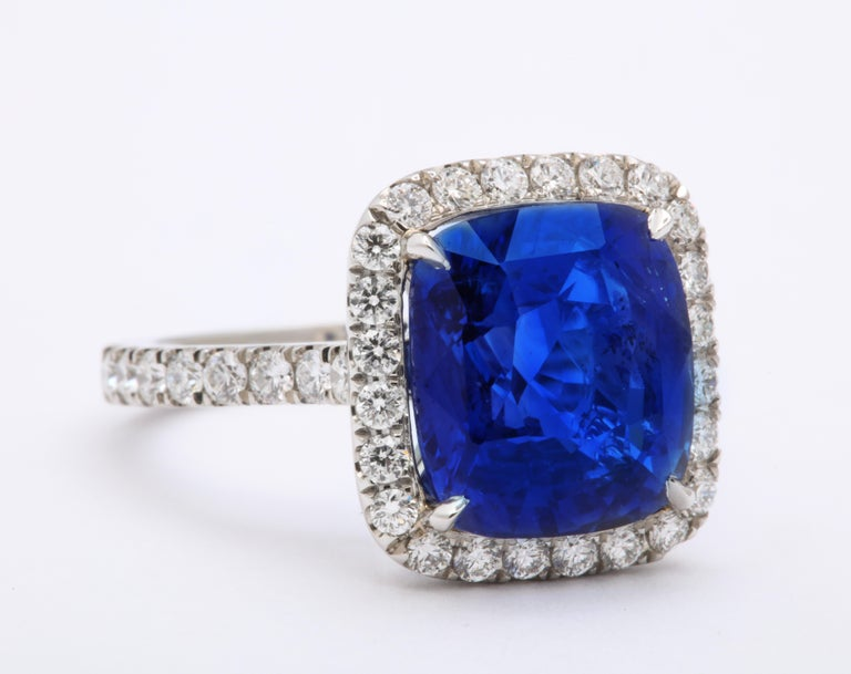 Women's or Men's 8 Carat Cushion Cut Ceylon Blue Sapphire and Diamond Ring For Sale
