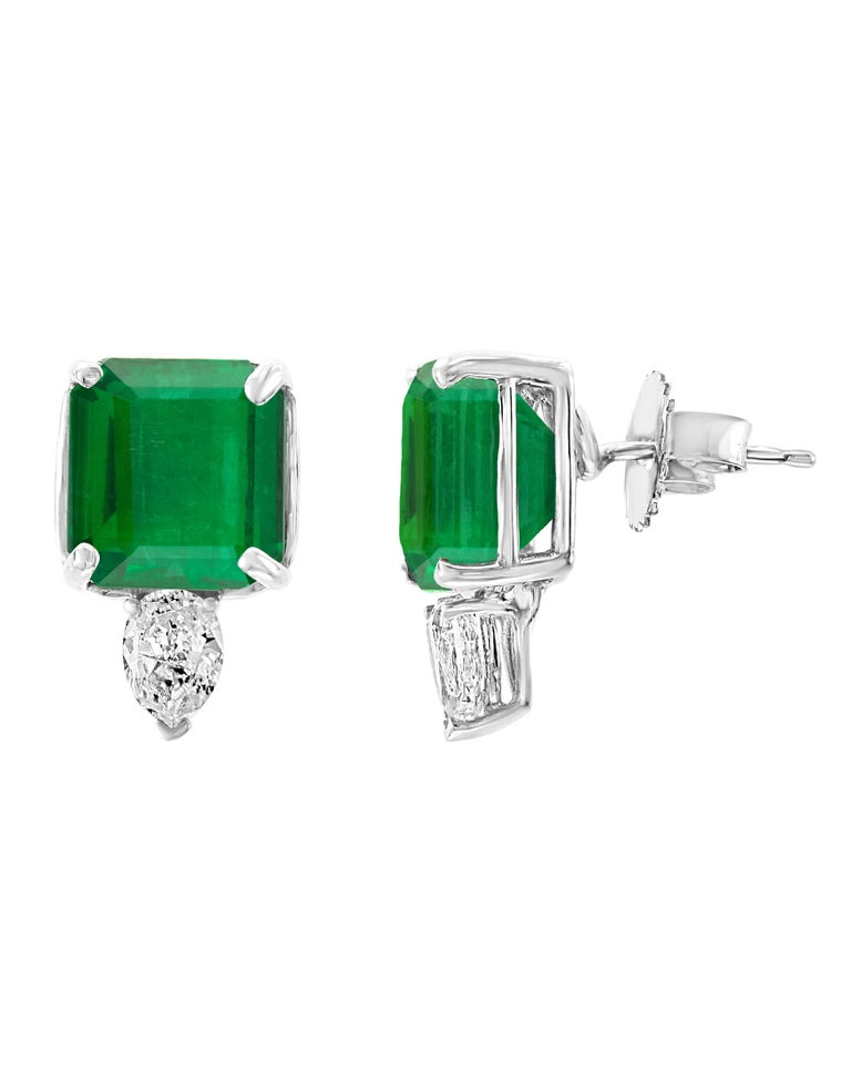 8 Carat finest  Emerald Cut Emerald  Diamond  Post  Earrings  18 Karat Gold  This exquisite pair of earrings are beautifully crafted with 18 karat White gold .  Fine   Emerald  Cut Emeralds weighing approximately 8  carats  and 1 carat diamonds