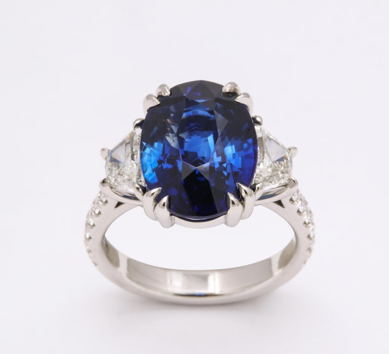 8.62 carat Vivid Blue Ceylon Sapphire!!  A fabulous and vibrant blue sapphire set in a fabulous custom diamond ring.   The ring features 1.45 carats of white side and round brilliant cut diamonds set in platinum.   The sapphire is certified by