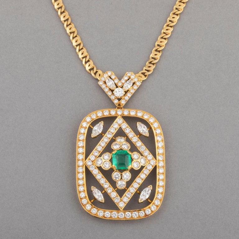 8 Carats Diamonds and 2 Carat  Emerald Pendant Necklace  Very beautiful necklace, probably Italian made circa 1980. The chain is made in yellow gold 18k. 50 cm for the length (20 inches). The pendant measures 6.8*4 cm  The diamonds weight 8 carats