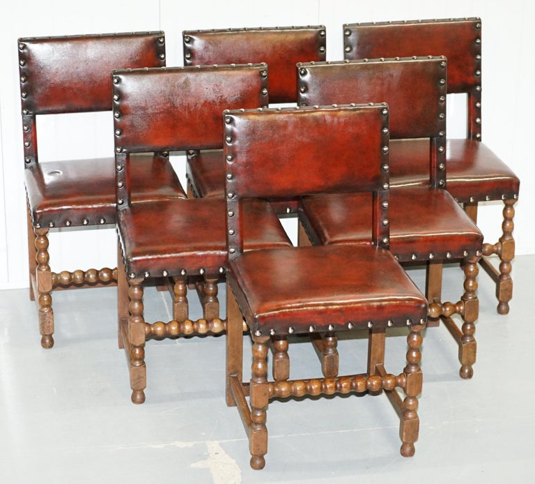 Wimbledon-Furniture is delighted to offer this stunning set of eight original hand carved solid oak bobbin turned Edwardian dining chairs with hand dyed whisky brown leather   These chairs are fully restored to include having the frames checked