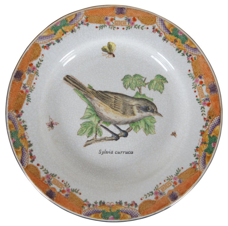 """Set of eight decorative ceramic plates with different species of birds and their scientific names, in the style of Victorian illustrations, surrounded by an orange and purple Asian border and artificial crazing. """"Wong Lee International Company of"""