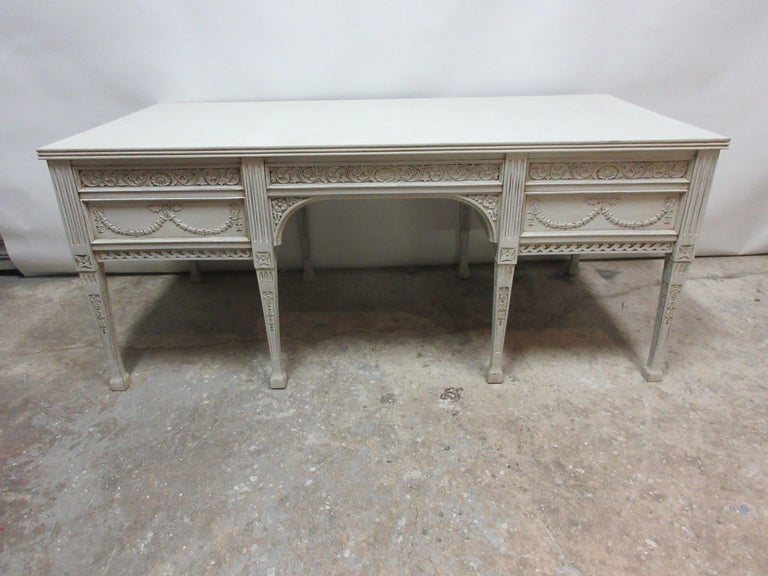 This is an 8 leg Gustavian Style carved desk , its restored and repainted with milk paints