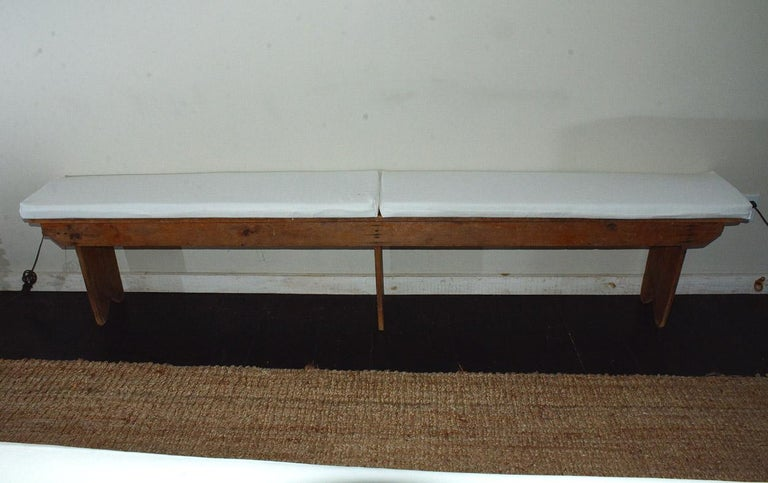 19th century antique bench extending approximately 8 feet in length, three board legs. Beautiful rustic patina, showing character from it's prior paint, stain, use and age. Great way to add a bit of casual-ease and comfort to any living space. Good