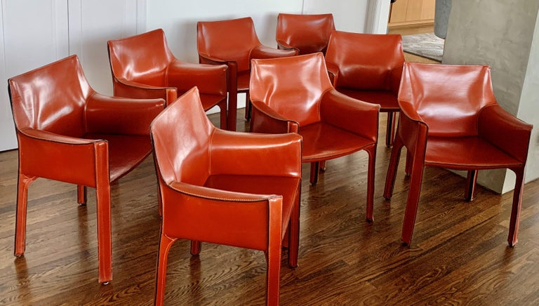 Photos TBU!  Set of 8 Mario Bellini CAB 413 chairs, made by Cassina in the 1990s. Flexible steel frame covered with a skin of high quality Russian Red (also known as Bulgarian Red) saddle leather. This elegant, versatile chair is equally suitable