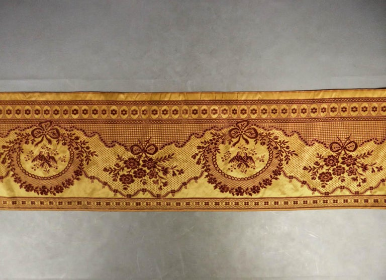 18th-19th century France  Large border of furniture in Louis XVI style chiseled velvet . Caramel taffeta background, plum-colored curly velvet drawing of a wide ribbon of tied and beaded medallions with ribbons and birds. Panel complete with
