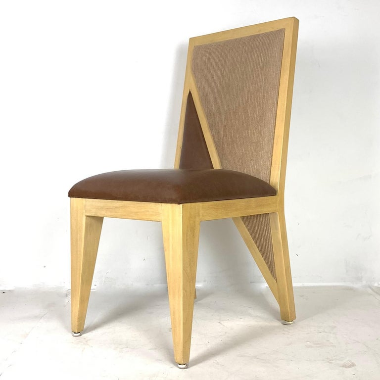Fantastic set of very sturdy solid wood Postmodern chairs. 6 side chairs and 2 armchairs. These chairs are stunning. Seat upholstery is in Naugahyde for practical purposes.