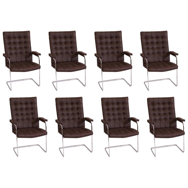 8 Stendig Leather and Steel Cantilevered Dining Chairs For Sale