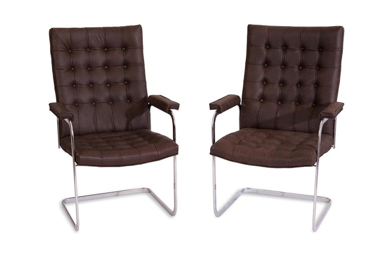 Set of 8 leather and mirror polished steel dining chairs by Stendig circa early 1970s. These examples have been newly upholstered in a pebbled chocolate brown leather. Price listed is for the set of 8.