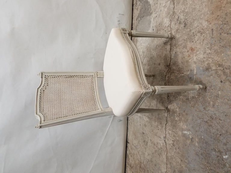This is a set of 8 Swedish Gustavian cane back chairs, they have been restored and repainted with milk paints