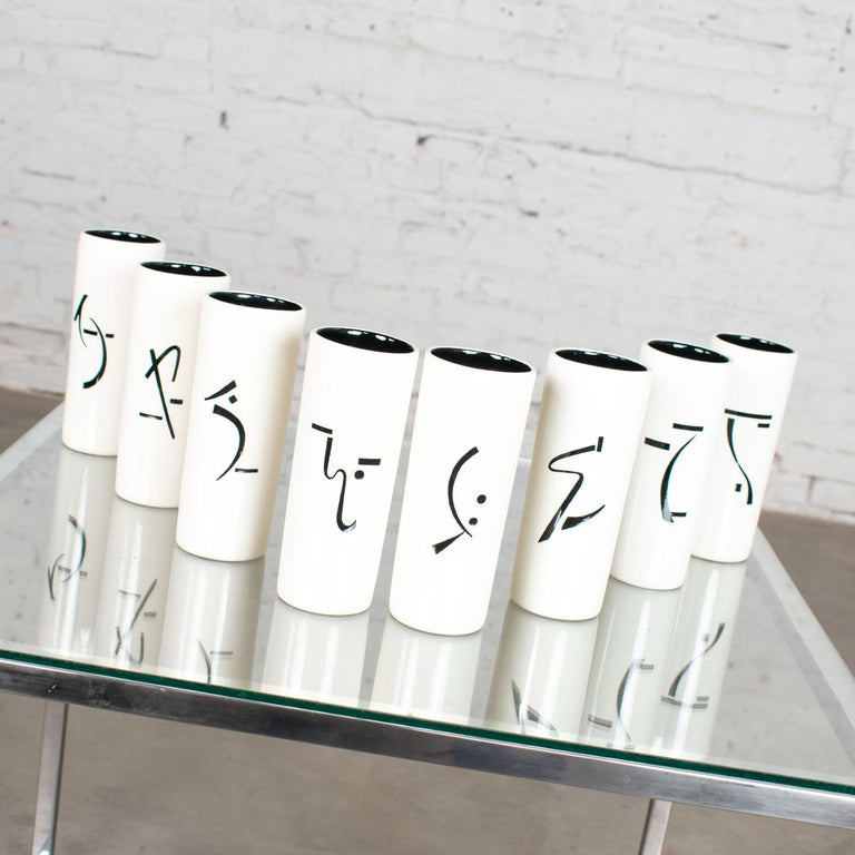 Gorgeous set of 8 vintage ceramic tumblers with Asian symbols in black and white. In amazing vintage condition. There are no chips, cracks, or chiggers we have detected. Please see photos, circa 1950-1960.