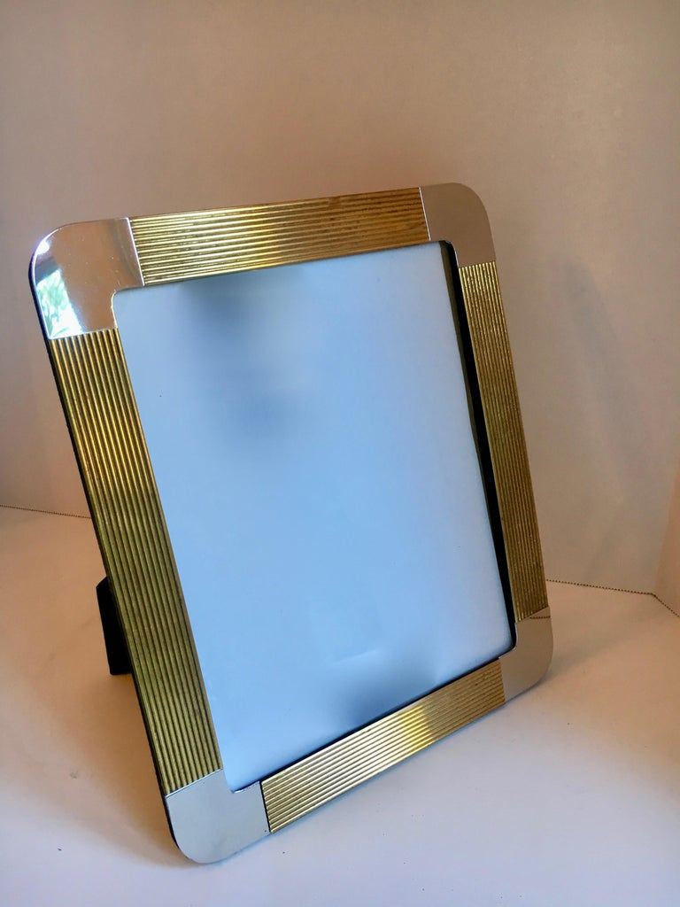 8 x 10 brass and chrome picture frame - holding memories in style. A stylish frame with black velvet reverse.