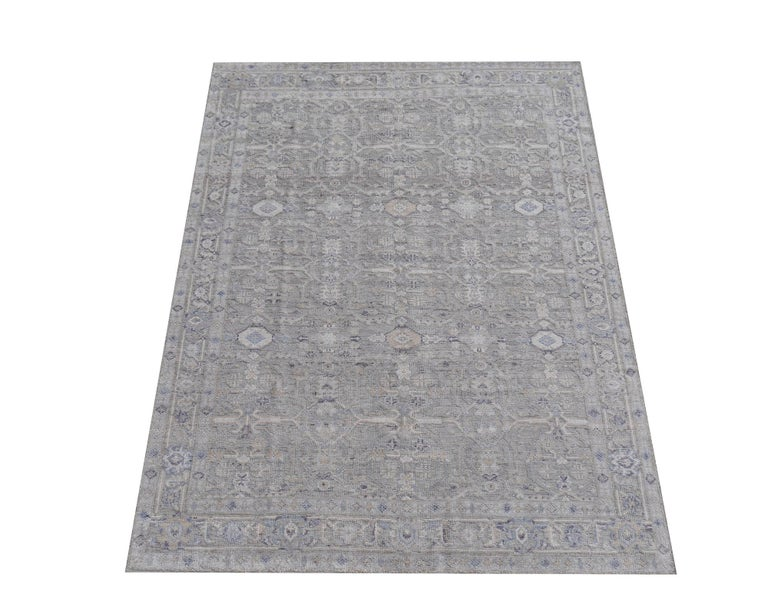 A beautiful 8 x 10 ft. modern Oushak Durva rug hand knotted wool pile and bamboo silk. On a light grey field, the design of traditional Oushak and Heriz elements standing next to each other executed in beiges, blues and grey tones.