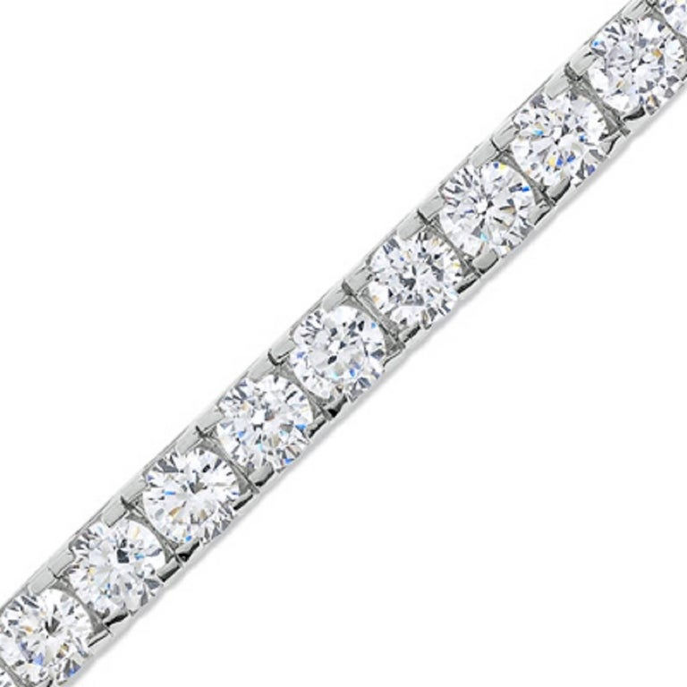 This beautiful Diamond bracelet is set on a 14k white gold. The color is G-H and the clarity is SI  We have one week return policy, if you are not satisfied with the item, plus, a life time guarantee for any upgrade you would ever want.