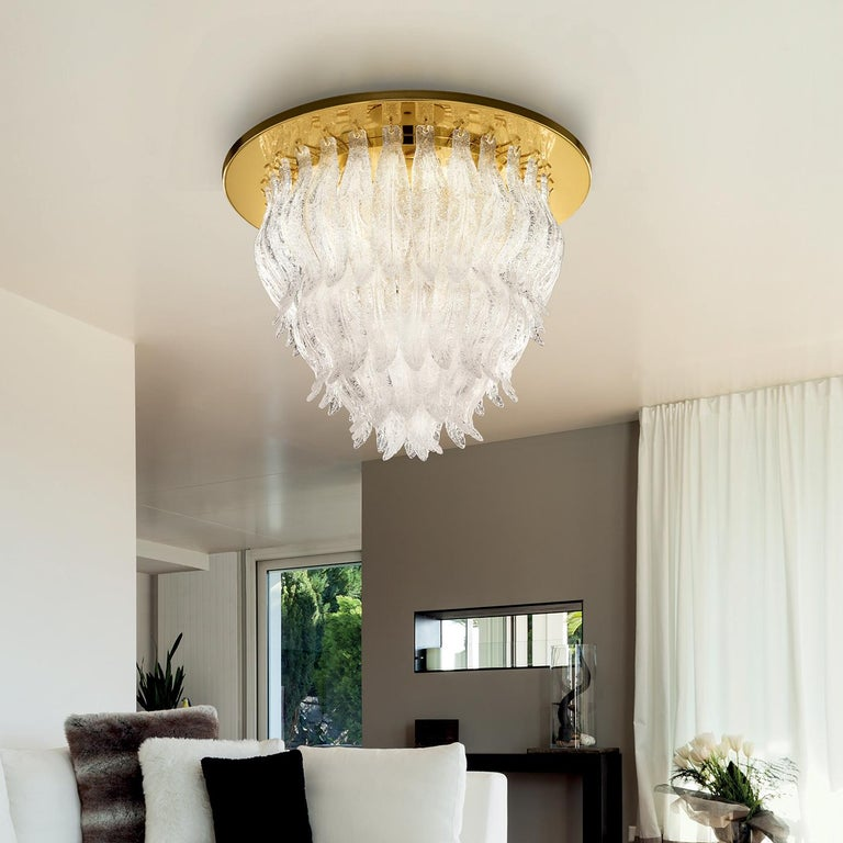 A spectacular design is the characterizing feature of this dazzling crystal ceiling light. This fabulous lighting fixture boasts a cascade of decorative crystals in layered circular rows which is perfectly complimented by the structure detail in