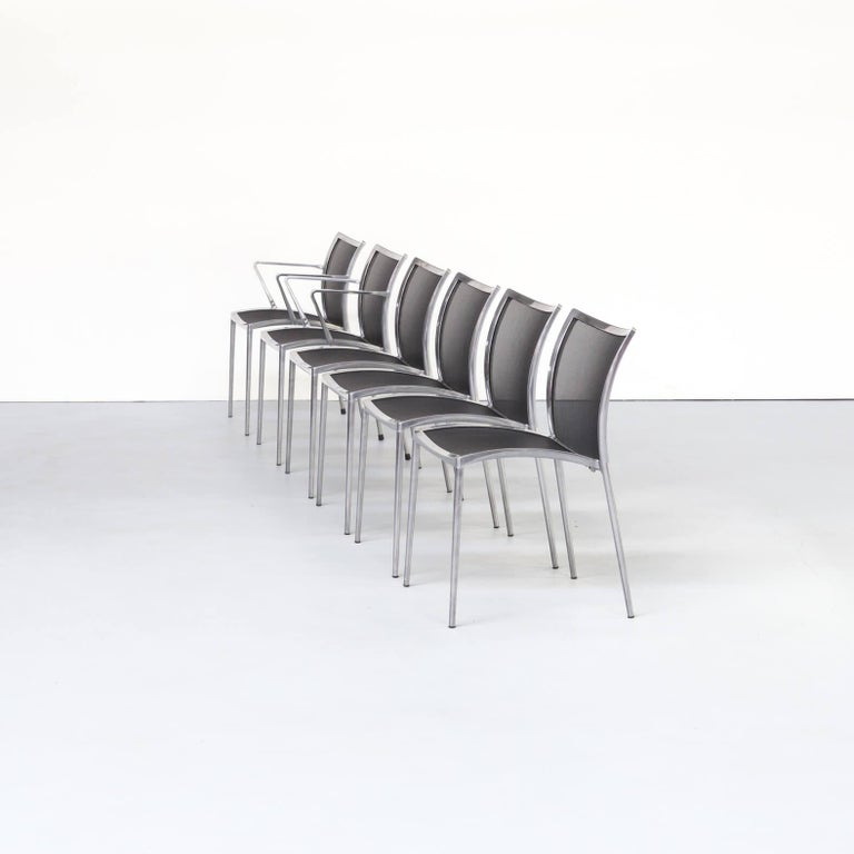 1980s aluminium and netwaeve dining chairs for Zanotta, set of 6. These beautiful strong aluminium framed chairs (two pieces with armrests) and the black netwaeve back and seat show strong and low weight in the same design. Due to the material use