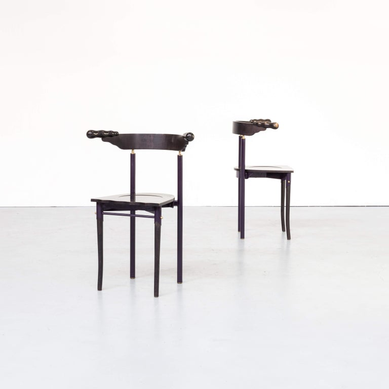 The 'jansky' chair has been designed in 1986-1988 by Borek Sipek, as usual with all his remarkable designs with design in front of functionality. Rare to find in black ashwood and dark purple metal framing this unique set of two manufactured by the