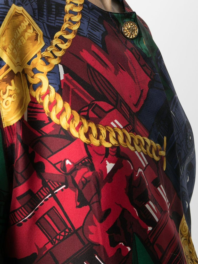 Stunning vintage silk shirt from Céline. Crafted from 100% silk, featuring long sleeves, logo engraved top button, and an all over print of Parisian monuments in striking primary colours.  Colour: Multi  Composition: 100% Silk  Condition: Very