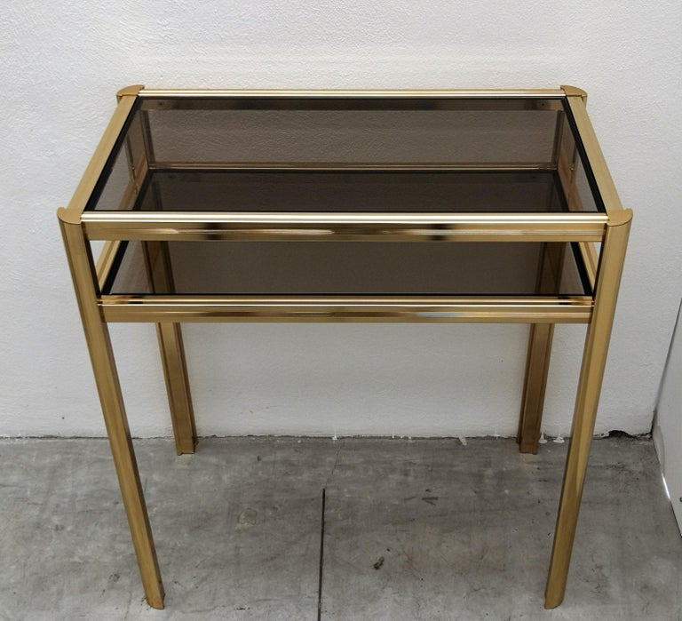 20th Century 1980s Hollywood Regency Mid-Century Modern Brass and Smoked Glass Console For Sale