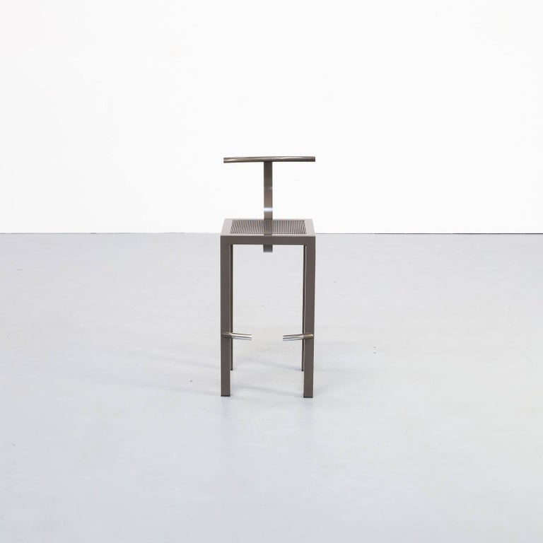 Philippe Starck designed the saparis stool in the 1980s combining straight and round forms together. Tubular steel frame mesh seat and half cirkel round backrest. The stools have been available in two heights. This version concerns the 90cm height