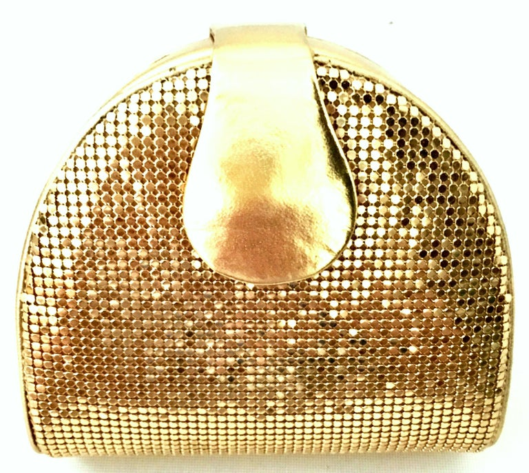Vintage Whiting & Davis Gold Metal Mesh & Gold Metallic Leather Hand Bag. This unique hard sided clutch, cross boy or shoulder hand bag features a gold plate chain link shoulder strap that can be tucked in when not in use. The gold chain link