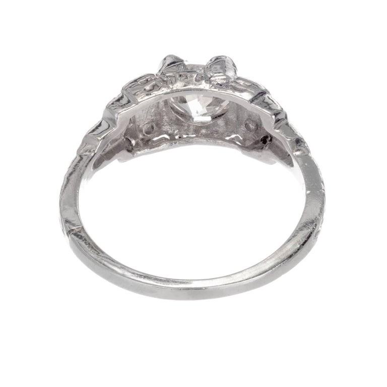 Round Cut .81 Carat Diamond Cushion Cut Art Deco Platinum Engagement Ring For Sale