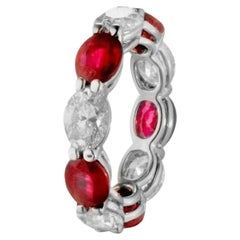 8.10 Carat Ruby and Oval Diamond East West Eternity Band Ring