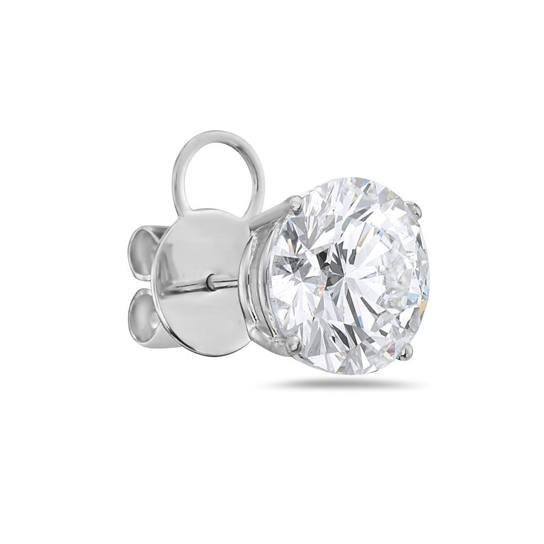 These diamond stud earrings feature two G VS1 diamonds weighing 4.03 and 4.08 carats each, xxx no fluorescence. Mounted in 18K white gold 4 prong setting. GIA certified. Report No. 5171427180/5172546076.  Viewings available in our NYC showroom by