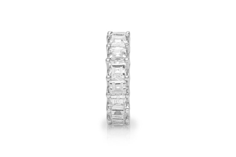 Estate Platinum Eternity Ring features 16beautifully matched square emerald cut diamonds, weighing a total of 8.12carats. Ring Size 5.5. May be sized upon request.Additional charges may apply. Circa 1990's.