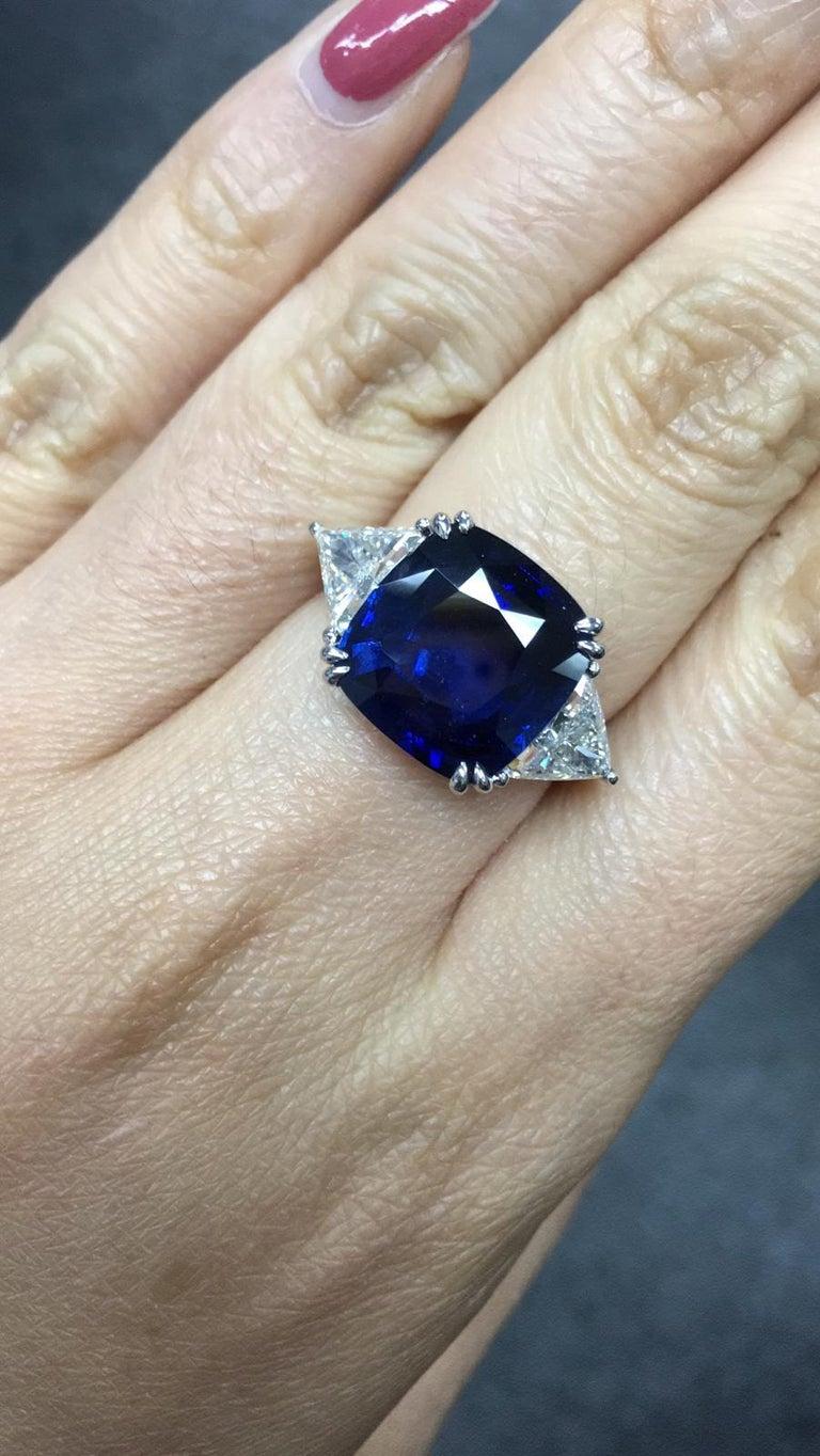 Primary Stone: Sapphire ( Sri Lanka ) Shape : Cushion Cut Sapphire Weight: 8.15 Carats  Measurements Sapphire: 12.10mm x 11.69mm x 5.98mm Color: Vivid Blue Accent Stones: Genuine Diamond Shape Or Cut Diamond: 2 Triangular Brilliants Average