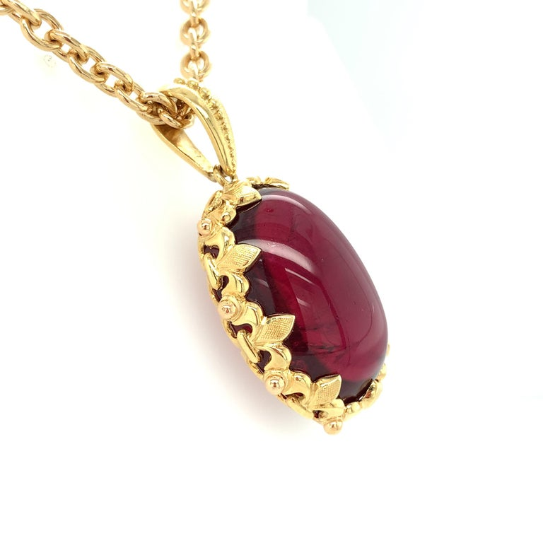 Artisan 81.59 Carat Rubellite Cabochon Oval Handmade Yellow Gold Drop Pendant For Sale