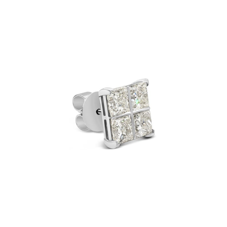 This pair of earrings feature 8 princess cut diamonds weighing 8.17 carats total.  Each earring has 4 diamonds set in such a way that it gives the impression of 1 large diamond earring. Set in 18k white gold. Diamonds are perfectly matched and