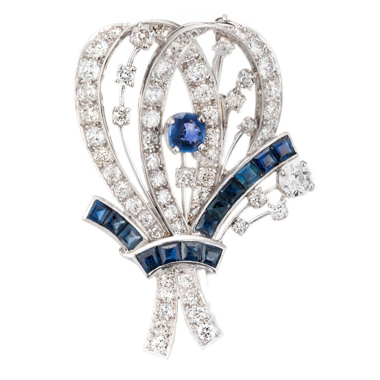 8.22 Carat Diamond Sapphire Platinum Flower Brooch, circa 1940s For Sale