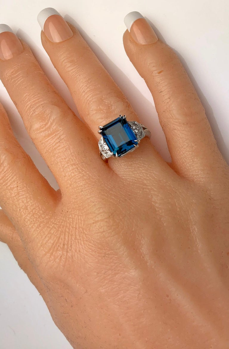 Contemporary DiamondTown 8.29 Carat Emerald Cut Vivid Blue Topaz Ring in 14 Karat White Gold For Sale