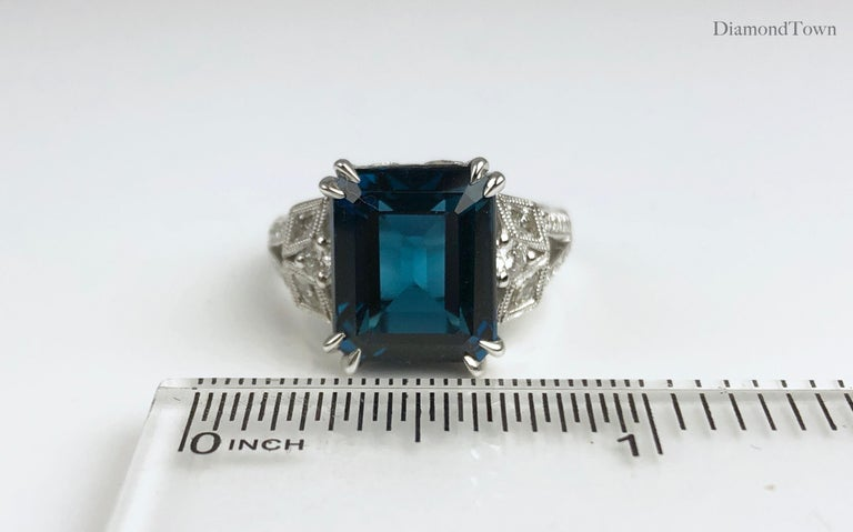 DiamondTown 8.29 Carat Emerald Cut Vivid Blue Topaz Ring in 14 Karat White Gold In New Condition For Sale In New York, NY