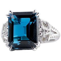 DiamondTown 8.29 Carat Emerald Cut Vivid Blue Topaz Ring in 14 Karat White Gold