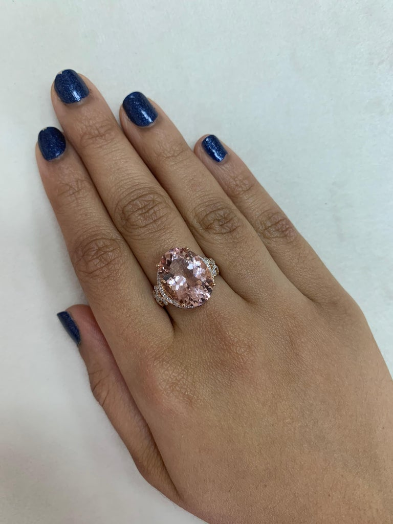 This collection features an array of magnificent morganites! Accented with diamonds these rings are made in rose gold and present a classic yet elegant look.   Classic morganite ring in 18K rose gold with diamonds.   Morganite: 8.306 carat oval