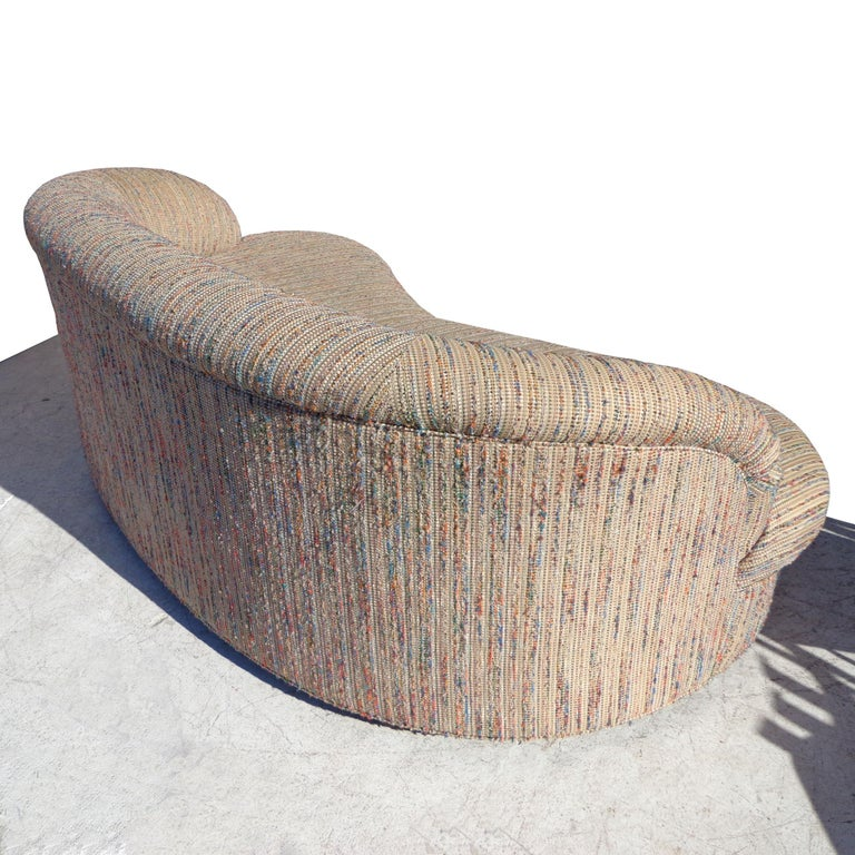 83? Modern curved kidney shaped sofa   Kidney-shaped sofa with a sculptural design. Arched low-profile back. Upholstered in a textured cotton blend.