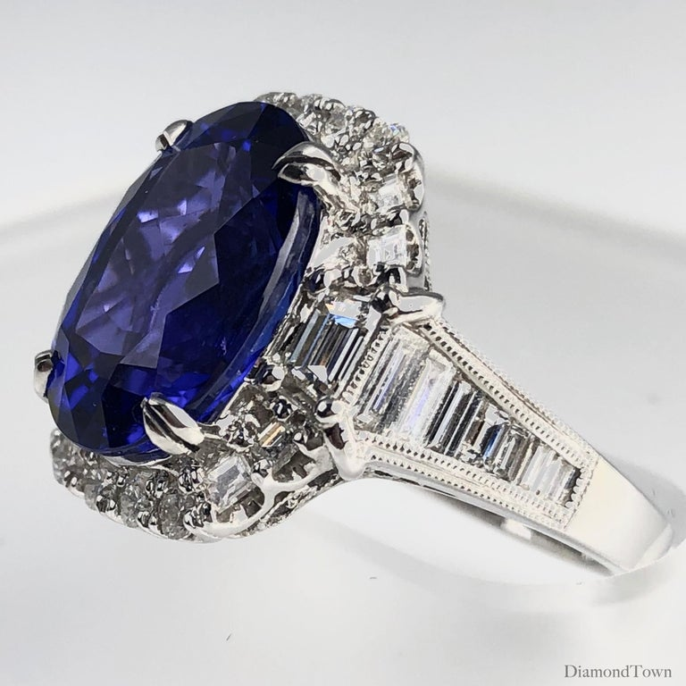 Contemporary GIA Certified 8.30 Carat Oval Cut Bluish Violet Tanzanite and Diamond Halo Ring For Sale