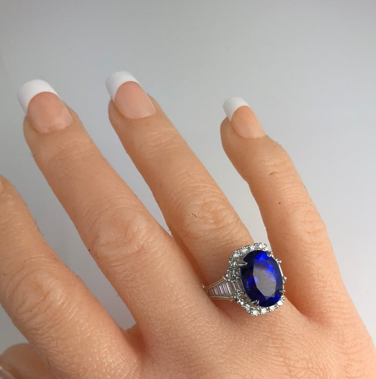 GIA Certified 8.30 Carat Oval Cut Bluish Violet Tanzanite and Diamond Halo Ring In New Condition For Sale In New York, NY