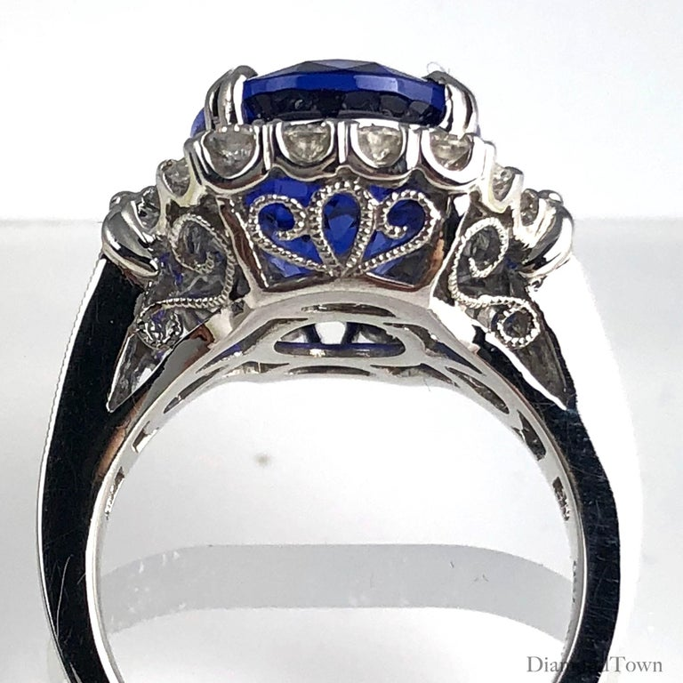 Women's GIA Certified 8.30 Carat Oval Cut Bluish Violet Tanzanite and Diamond Halo Ring For Sale