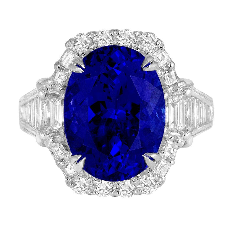 GIA Certified 8.30 Carat Oval Cut Bluish Violet Tanzanite and Diamond Halo Ring For Sale
