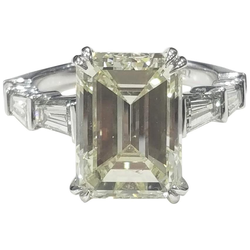 8.31 Carat Emerald cut White Diamond And Baguette Ring In 18K Gold.