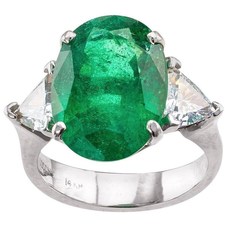 8.32 Carat Emerald Diamond Three-Stone White Gold Ring For Sale
