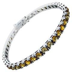 8.37 Carat Light Orange Sapphire 18Kt White Gold Tennis Bracelet