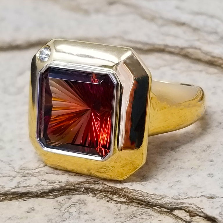 The bold Aphrodite ring pairs a knockout scale with can't-miss-it voluptuous lines. This 18kt and platinum version features a singular Orgeon Sunstone with a fine diamond accent.  The richly colored 8.43ct Oregon Sunstone was given cut by gemcutting