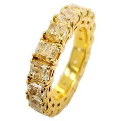 8.45 Carat Share Prong Fancy Yellow Radiant Diamond 18 Karat Gold Eternity Ring